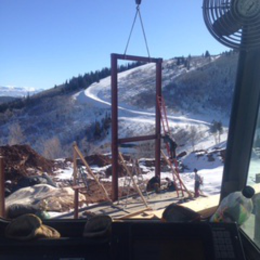 Crane working on a house in Park City